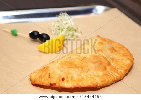 Original Serving Of Meat Pie In A Restaurant. Belyash With Meat. Argentinian Empanada. Tatar Meat Pi