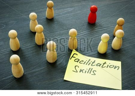 Facilitation Skills Concept. Wooden Figurines As Symbol Of Teamwork.