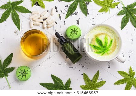Cbd Infused Coffee And Macarons On White Background. Hemp Oil, Tea And Pills. Alternative Medicine C