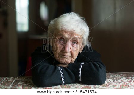 Close-up portrait of an elderly meloncholic pensioner woman.