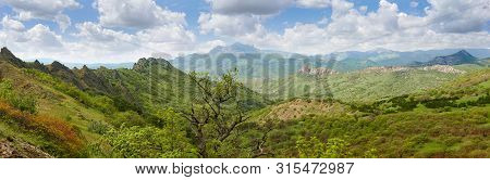 Mountain Landscape With Rock Outliers Among Forest And Remote Mountain Ranges On A Background In Spr