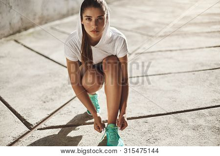Motivation, Urban Fitness And Running Concept. Determined Alluring Young Fit Female Workout Outdoors