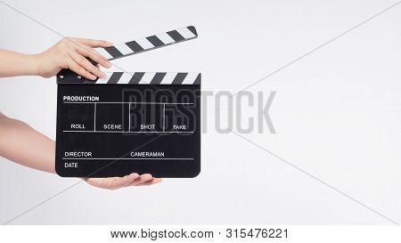 A Man's Hands Is Holding Black Clapperboard Or Movie Slate. It Use In Video Production ,film, Cinema