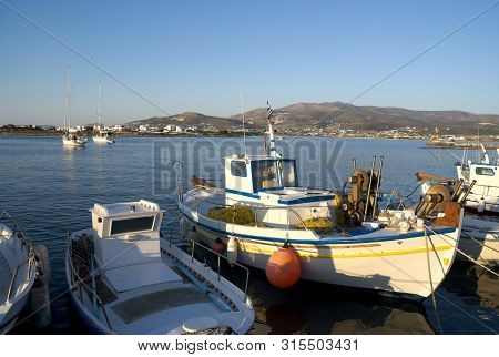 Greece, The Holiday Island Of Antiparos.  Small Fishing Boats At Anchor At The Quayside. The Island