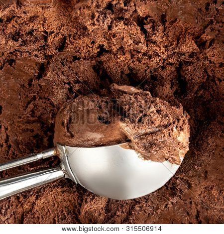 Chocolate  Ice Cream Scoop.  Dark Cocoa Ice-cream Background Or Texture. Top View