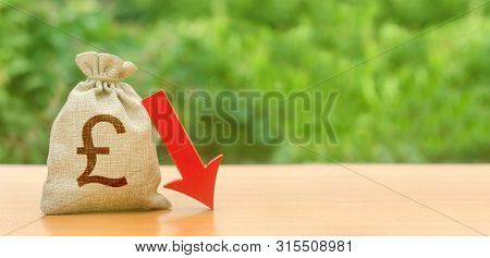 Money Bag With Pound Sterling Symbol And Red Arrow Down. Depreciation Of The Pound, Economy Fall And