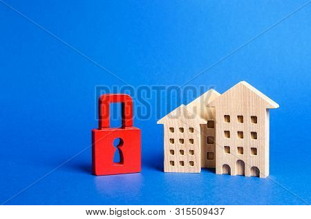 Three Houses And A Red Padlock. Unavailable And Expensive Real Estate. House Insurance. Security And