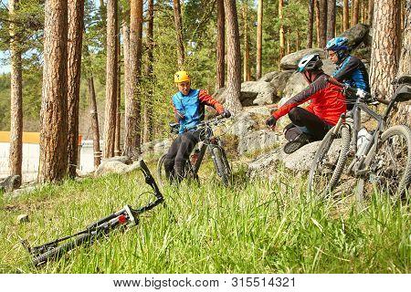 Group Of Cyclists On A Halt. Mountain Bike Team Outdoors