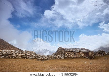 A View Of Amphu Gyabjen And Ama Dablan Peaks With Old Stone Hut, Everest Base Camp Trek, Nepal