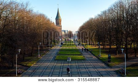 Kaliningrad, Russia - December 30, 2017: People Walking Near Cathedral Of Immanuel Kant In Kaliningr