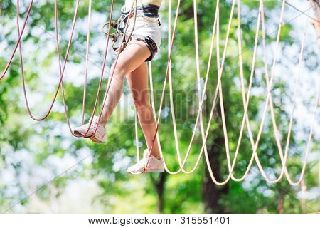 Rope Park. Foot On The Rope. Man Spend Their Leisure Time In A Ropes Course. Man Engaged In Rope Par