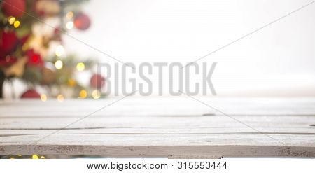 Christmas Holiday Background With Empty Wooden Table Top Over Festive Bokeh Light Decorate.
