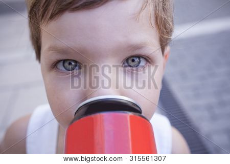 Little Drinking From Soft Drink Can. Children With Unhealthy Habit About Sugary Soft Drinks