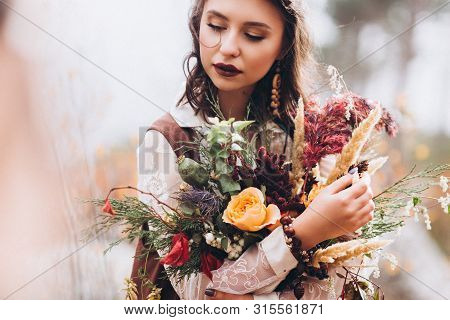 Girl In Boho Style On A Background Of Autumn Forest.
