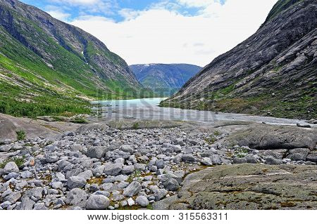 Beautiful Mountain River At Nigardsbreen Glacier