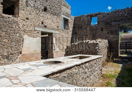 Ruins Of The Houses In The Ancient City Of Pompeii