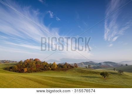 Fall In Slovakia. Meadows And Fields Landscape. Autumn Color Trees At Sunrise.