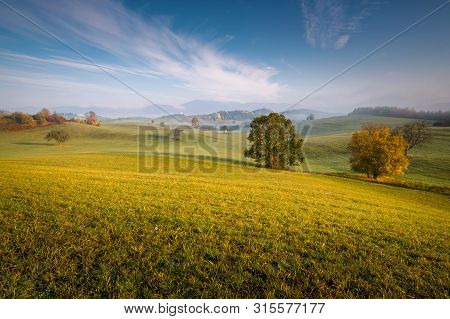 All In Slovakia. Meadows And Fields Landscape. Autumn Color Trees At Sunrise.