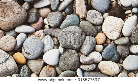 Pebble Beach Background, Stone Floor. Abstract Nature Pebbles Background. Sea Peblles Beach. Beautif