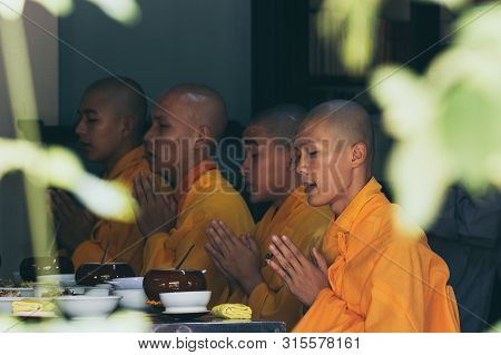 Hue, Vietnam - June 2019: Buddhist Monks Saying Traditional Prayer Chants Before Taking Their Meal I