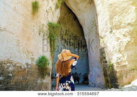 Beautiful Woman Comes Into The Ear Of Dionysius (orecchio Di Dionisio) In Syracuse, Sicily, Italy