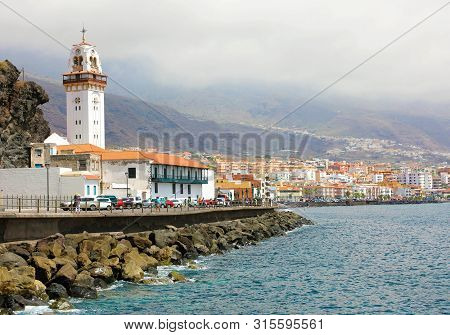 Tenerife, Spain - June 1, 2019: Beautiful View Of The Town Of Candelaria With The Basilica In The Ba