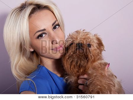 Young woman with a dog breed Griffon Bruxellois poster