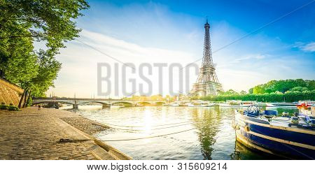 Paris Eiffel Tower Reflecting In River Seine At Sunrise In Paris, France. Web Banner Format. Eiffel