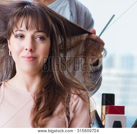 Man stylist working with woman in beauty salon poster