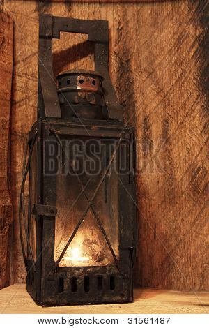 Old Lamp With Lighted Candle