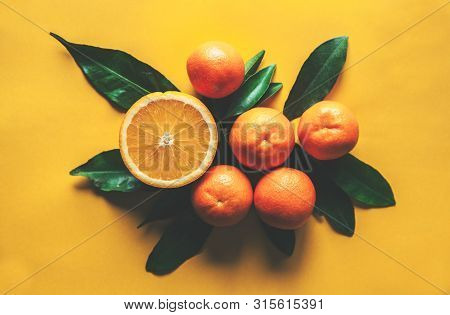 Fresh Tangerines Oranges On Yellow Background A