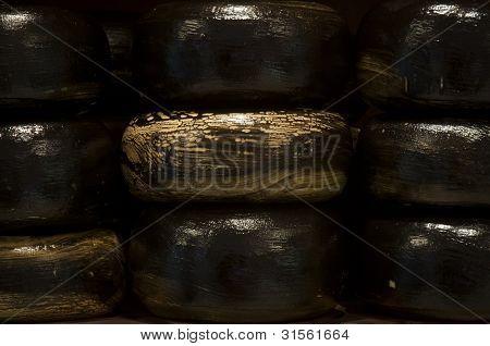 Nine big black Gouda cheese