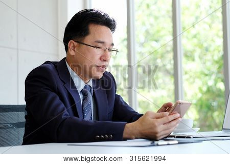Asian Businessman Using Phone While Working At Office, Ceo Business Asian Man With Smart Phone For C