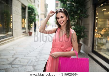 Young woman shopping in a city street