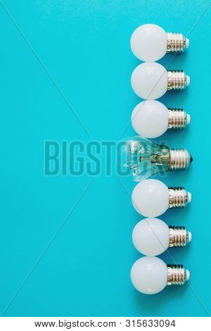 Lamps, Led Lamps And Fluorescent Lamps On Blue Background. Large Set Of Led Bulbs. White Energy-savi
