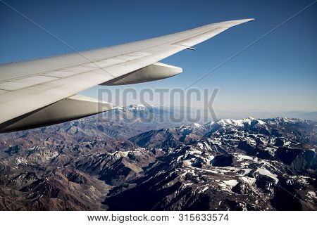 View Of Andes Mountain Range (cordillera De Los Andes) From Above With Airplane Wing