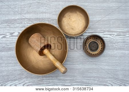 Flat Lay Composition Of Ancient Hand Crafted Traditional Tibetan Meditation And Healing Singing Bowl