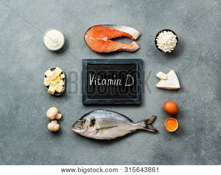 Vaitamin D Sources Concept. Fish, Salmon, Dairy Products, Eggs, Mushrooms And Chalkboard With Vitami