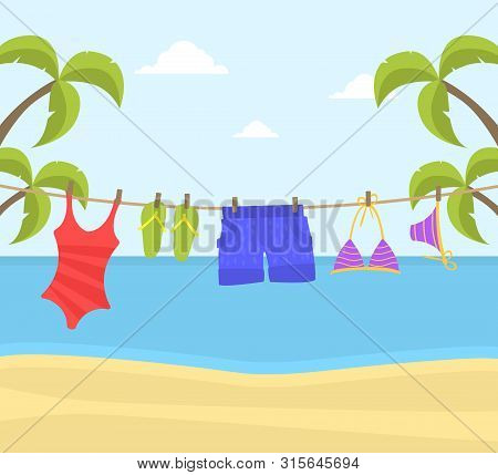 Beach Clothes Hanging On Rope, Swimwear And Flip Flops On A Clothesline On Beautiful Seaside Landsca