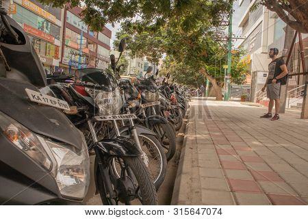 Bengaluru, India June 17, 2019 : A Lot Of Motor Scooters Parked In A Row On Road At Bengaluru, India
