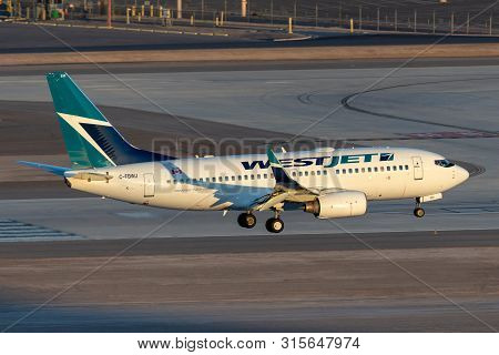 Las Vegas, Nevada, Usa - May 7, 2013: Westjet Boeing 737 Airliner On Approach To Land At Mccarran In