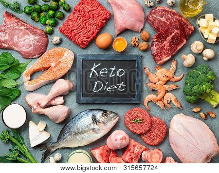 Keto Diet Concept. Raw Ingredients For Low Carb Diet - Meat, Poultry, Fish, Seafood, Eggs, Beef Bone