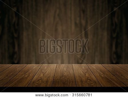 Wood Table In Front Of Wood Wall Blur Background.