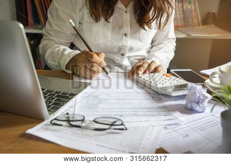 Budget Planning Concept,accountant Is Calculating Company's Annual Tax.calendar 2019 And Personal In