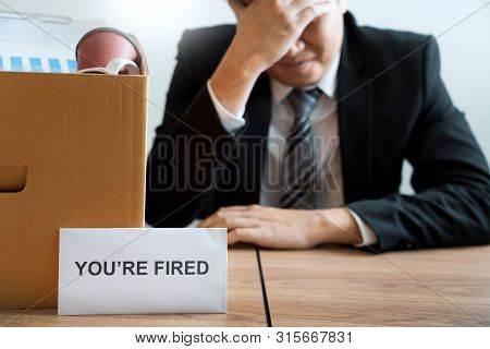 Businessperson carrying packing personal company on brown cardboard Box and resignation letters for quit or change of job leaving the office, unemployment, resigned concept. poster
