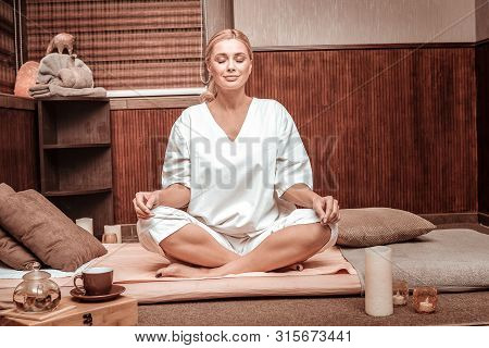 Smiling Woman Meditating Before The Tea Ceremony.