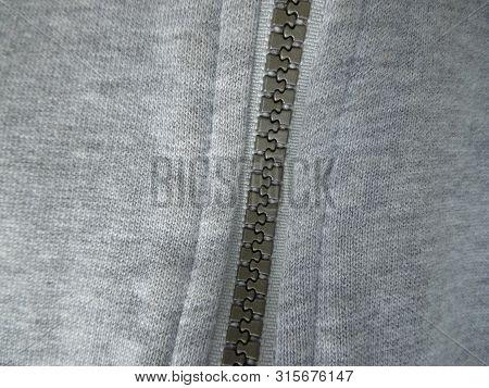 The Drawn Zipper On A Grey Cloth