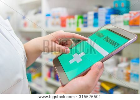 Pharmacist Holding Touchpad For Search Bar On Display In Pharmacy Drugstore Shelves Background.onlin