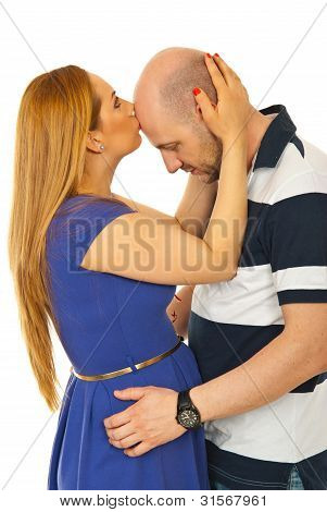 Woman kissing bald man forehead isolated on white background poster