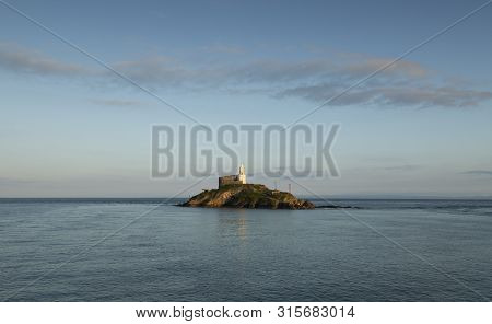 Mumbles Lighthouse Island The Iconic Landmark That Is Mumbles Lighthouse On The Gower Peninsula In S
